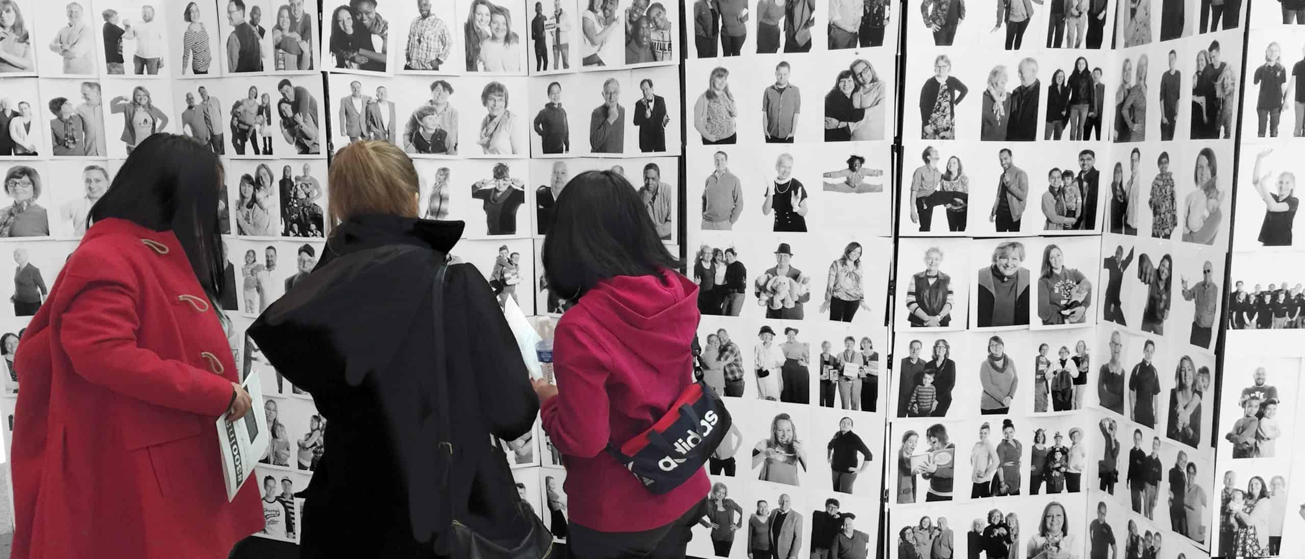ONEbyONE Community Portrait 3 women at wall